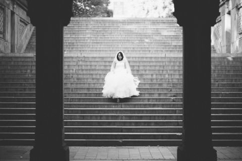Bride descends the stairs at Central Park during her bridal session with NYC wedding photographer Ben Lau.