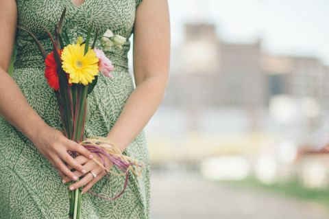 Girl holds flowers during her Baltimore engagement session with NJ wedding photographer Ben Lau.