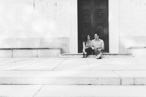 Couple sit in the doorway during their engagement session in Morristown with NJ wedding photographer Ben Lau.