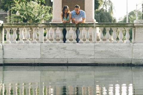 Couple stand by a reflecting pool during their engagement session in Morristown with NJ wedding photographer Ben Lau.