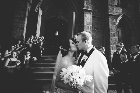 Bride and groom kiss outside of a church in Somerset, NJ. Captured by NJ wedding photographer Ben Lau.