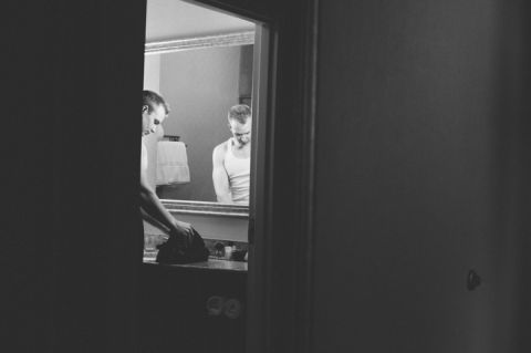 Groom preps for a wedding at The Palace at Somerset Park, NJ. Captured by awesome NJ wedding photographer Ben Lau.