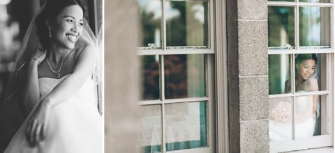 Bride looks out window on the morning of her wedding day at Tappan Hill Mansion in Tarrytown, NY. Captured by NYC wedding photographer Ben Lau.