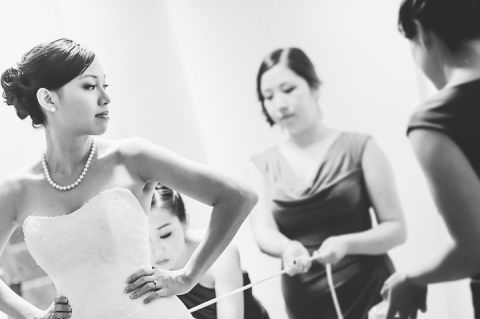 Bride gets ready at the Le Merdian in Crystal City, VA. Captured by NYC wedding photographer Ben Lau.