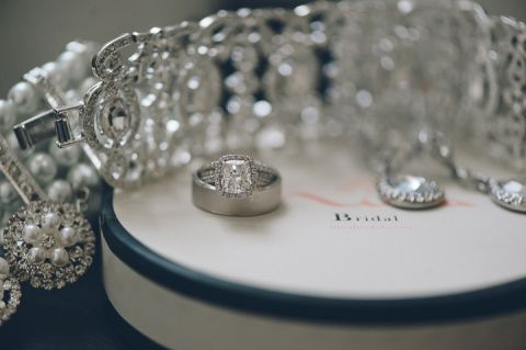 Wedding rings at the Belvedere Hotel in Baltimore, MD. Captured by NYC wedding photographer Ben Lau.