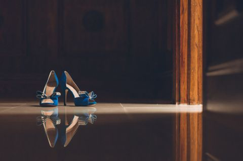 Wedding shoes photographed in a pocket of light at The Estate at Florentine Gardens in River Vale, NJ. Captured by Northern NJ wedding photographer Ben Lau.