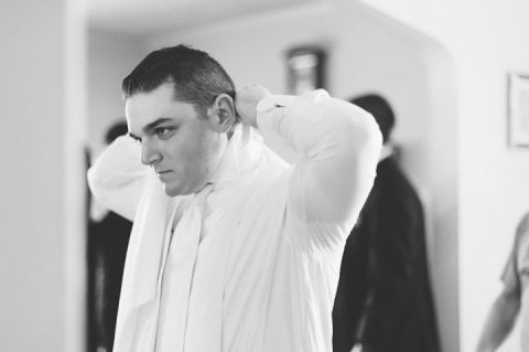 Groom prepares for his wedding day at St. John's University and Glen Cove Mansion. Captured by NYC wedding photographer Ben Lau.
