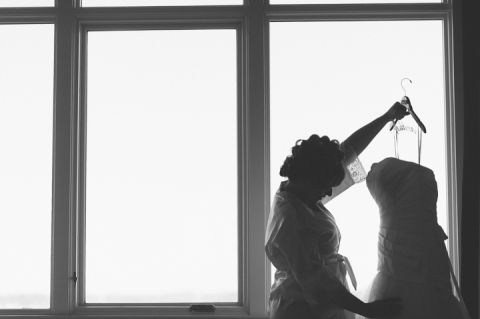 Bride looks at her dress at the Bungalow Hotel in Long Branch, NJ. Captured by NYC wedding photographer Ben Lau.