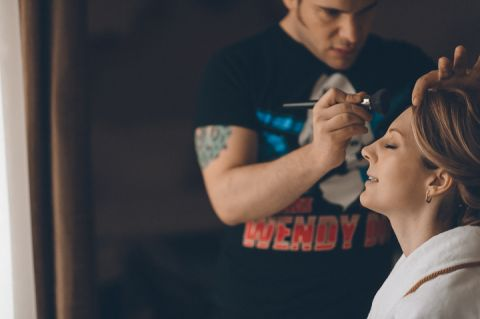 Bride gets her make up done for their New York City Hall wedding, captured by NYC wedding photographer Ben Lau.