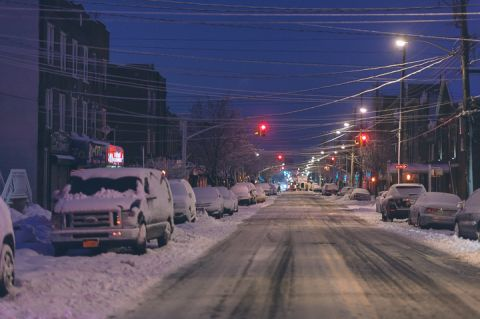 Snowy streets in Brooklyn. Captured by NYC City Hall Wedding Photographer Ben Lau.