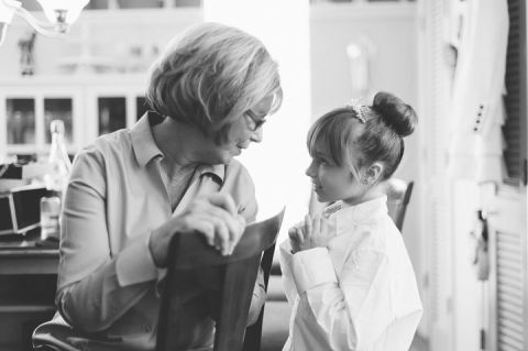 Flower girl talks to her grandmother on the morning of a wedding at the Westmount Country Club. Captured by Northern NJ wedding photographer Ben Lau.