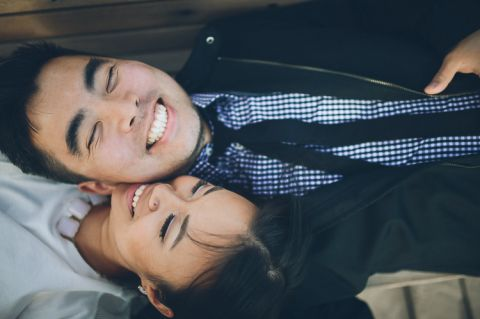 Yilan & Han's engagement session in Coney Island. Captured by Brooklyn Wedding Photographer Ben Lau.