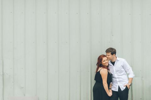 Yuriy and Alina hold hands during their engagement session in Baltimore with NJ wedding photographer Ben Lau.