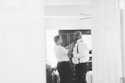 Groom preps on the morning of his wedding at Normandy Farms in Blue Bell, PA. Captured by Philadelphia wedding photographer Ben Lau.