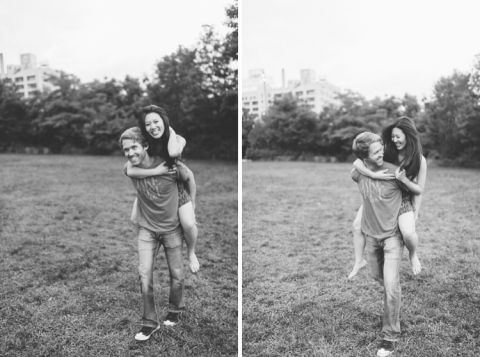 Laura & Jason play on the grass during their engagement session in DUMBO Brooklyn. Captured by NYC wedding photographer Ben Lau.