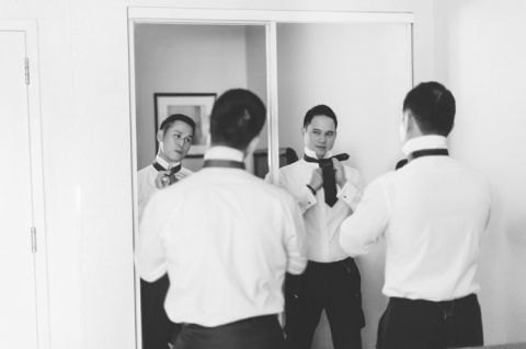 Groom preps in hotel room in Jersey City. Captured by NYC wedding photographer Ben Lau.