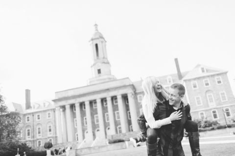 Lauren and Ben play around  the Old Main Lawn during their engagement session at Penn State. Captured by NYC wedding photographer Ben Lau.