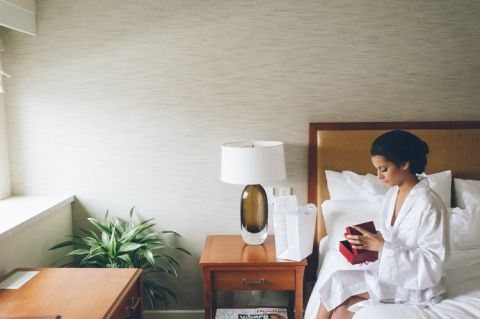 Bride gets ready on the morning of her Seaport Hotel wedding in Boston, MA. Captured by NYC wedding photographer Ben Lau.