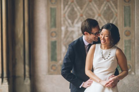 Couple share a kiss in the Bethesda Arcade during their engagement session in Central Park. Captured by NYC wedding photographer Ben Lau.