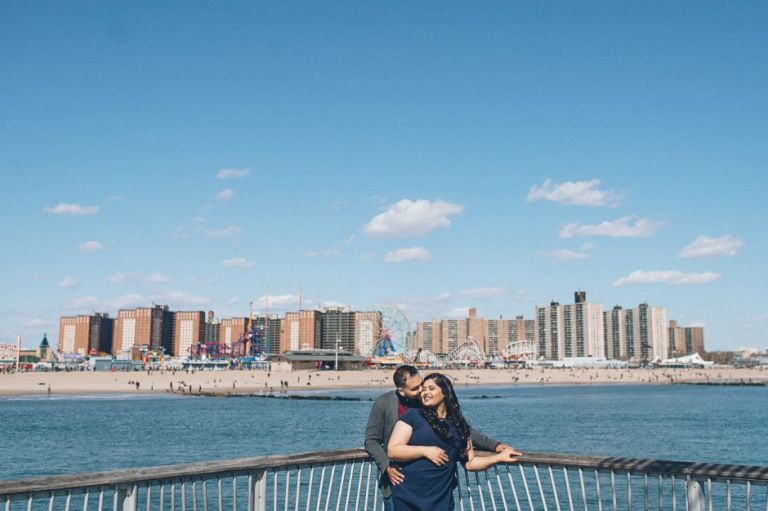 Coney Island engagement session in Brooklyn, NY - captured by photojournalistic NYC wedding photographer Ben Lau.