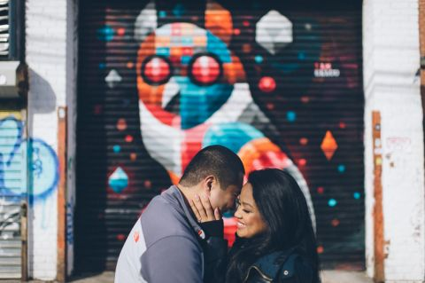 Fun Queens NYC engagement session featuring graffiti murals, silhouettes and parking garages, captured by NYC wedding photographer Ben Lau.