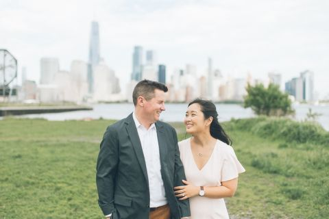 Fun Jersey City engagement session with the NYC skyline, captured by North Jersey wedding photographer Ben Lau.